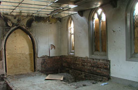 Inside the building before restoration. Select the image to see a larger view