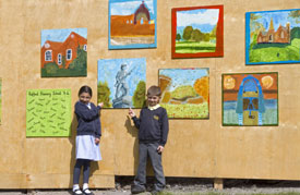 Primary school children created paintings to decorate the hoardings. Select the image to see a larger view